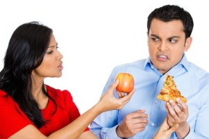 Woman persuading guy for eating balanced diet